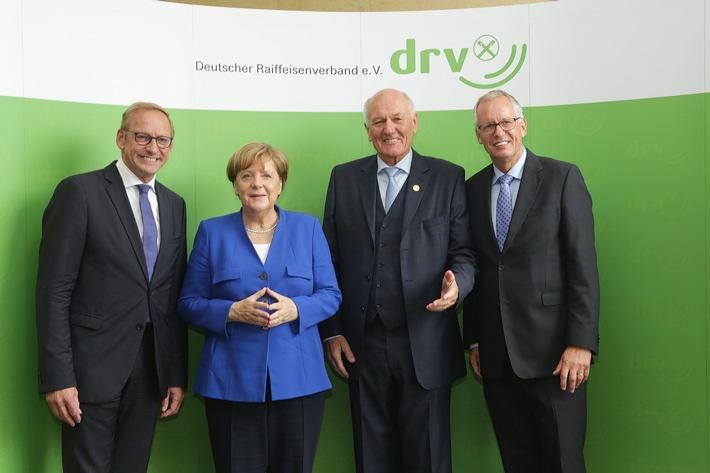 Nüssel verabschiedet: Bundeskanzlerin unterstreicht die Erfolgsstory der Genossenschaften